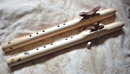 Basic yellow cedar kid's flute (top) and Boat and Fish flute (below)