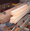 Square-sectioned cedars ready to cut for flute blanks
